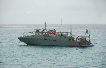 Military patrol boat anchored near the coast