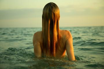 girl in sea waves