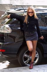 cute girl and luxury car