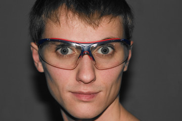 Sight of the young man in sports glasses