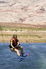Girl Wakeboarding at Lake Powell