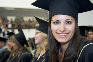 student graduating in black gown