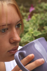 Teenager drinking a from a large mug