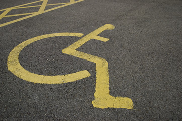 detail of yellow disabled parking bay