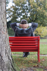 Businessman relaxing in a park