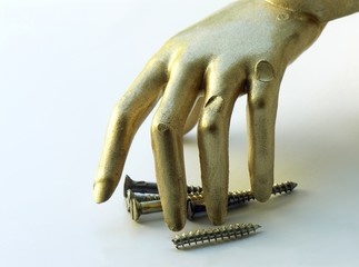 gold hand of clever handy-man