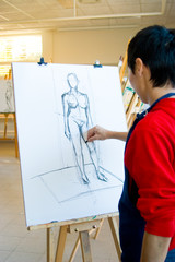 young artist drawing in studio