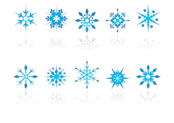 Different snow crystals with reflection over white background
