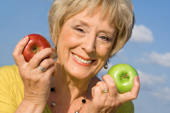 happy smiling attractive senior woman, healthy eating