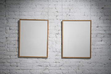 two blank frames on the white wall