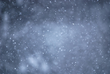 snowflakes in air with telephoto lens