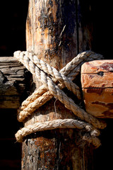 Rope, nail and wooden surface