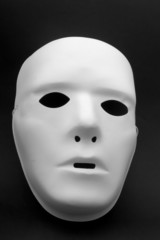 A white mask on a black background