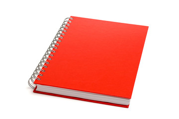 Red notebook isolated on white. Shallow DOF