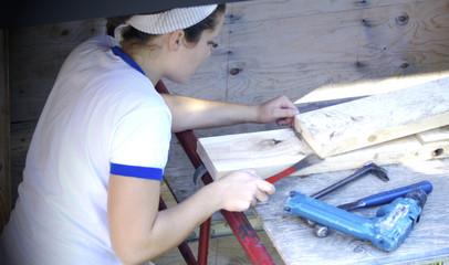 Young woman carpenter
