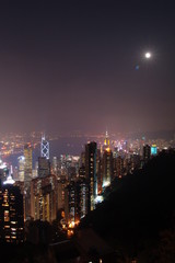 Hong Kong cityscapes at full moon night viewed from The Peak