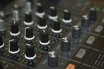 black buttons on dj mixing equipment tool
