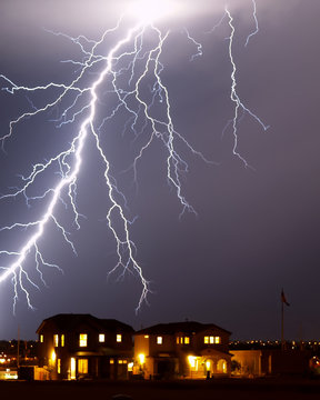 Lightning over a home - Tucson, AZ