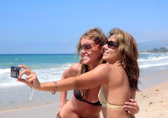 Young pretty women on sunny beach