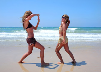 Young women on sunny beach