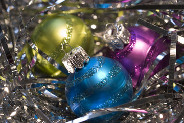 Three pretty Christmas ornaments and shiny silver gift fillers