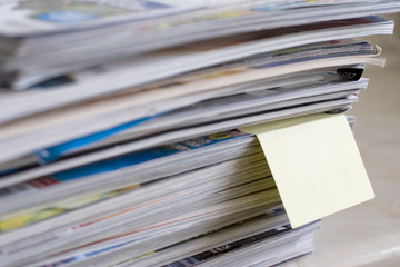 magazines with post it note