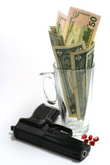 gun with dollar in glass and pomegranate corn / seed