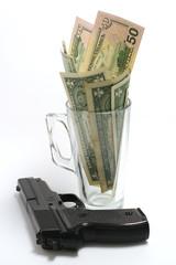 gun with dollar in glass