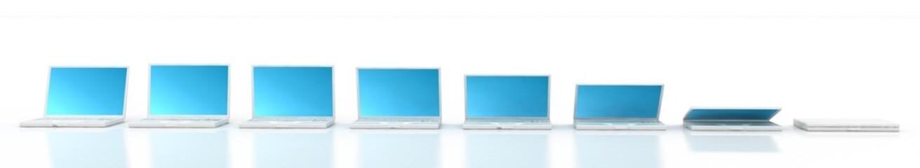 closing of white laptop