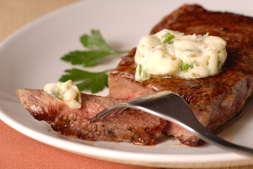 Grilled ribeye steak with a bernaise butter