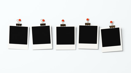 Five polaroid blanks on a wall 3D