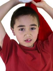 boy plays with santa cap