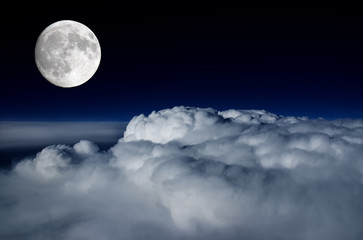 Full moon above cloud deck