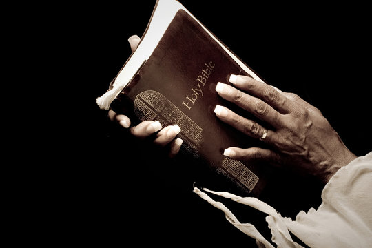 african american hands holding bible