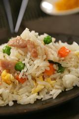 Nasi goreng with pork stripes and chopsticks
