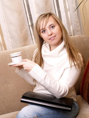 Young woman after lecture with folder and coffee.