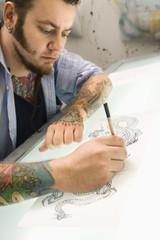 Man drawing tattoo.