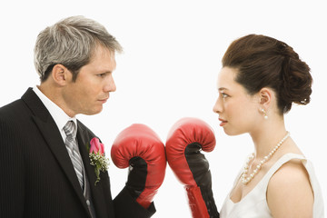 Wedding couple with boxing gloves.