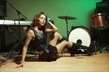 Female posing with instruments.