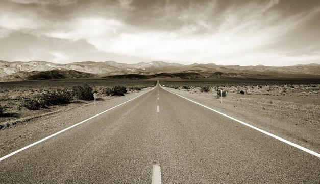 Empty californian highway through the desert