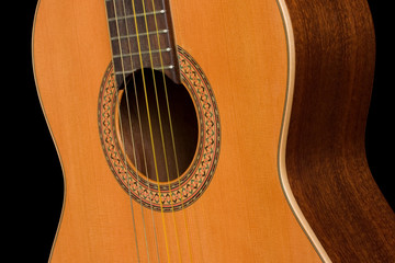 Classical guitar close up on dark background
