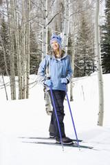 Female skier on slope.