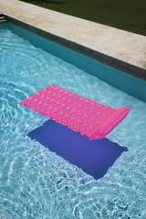 Pink float in  pool.