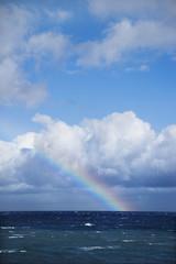 Ocean with rainbow.