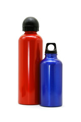 Red and blue metallic bottles on white