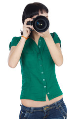Pretty girl taking a photograph with camera