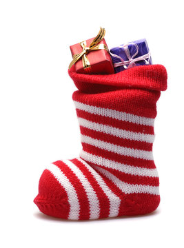 christmas stocking with gifts  isolated on white