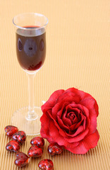 Small after-dinner wine glass with a red rose and glass hearts