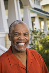 African American middle aged man smiling at viewer.