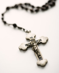 Rosary with crucifix.